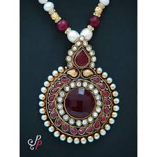 bold and beautiful pearl necklace set in large polki pendant and earrings