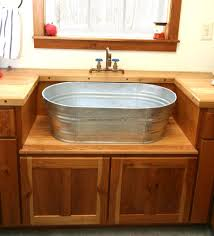 rustic laundry sink and cabinet