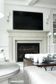 tv on fireplace mantel light gray limestone with niche mount above