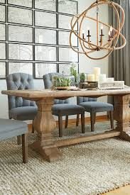 arlington round sienna pedestal dining room table w chestnut finish. the large scale arlington chandelier is a geometric conversation piece. hemp wrapped metal sphere round sienna pedestal dining room table w chestnut finish e