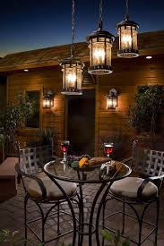 stylish patio lighting ideas 12 with rustic chandelier above glass table and metal chair