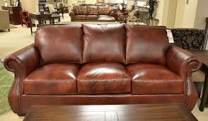 Leather sofa with nail-head studded trim.