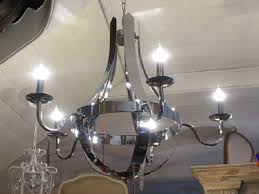 contemporary chrome 6 arm chandelier on display in our southport furniture showrooms