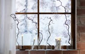 ikea lighting ideas. a close up of twisted birch twigs in glass bottles with decorations hanging from them ikea lighting ideas n
