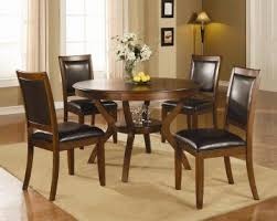 the 5 pc calgary round walnut dining table set by true contemporary its have a versatile and cal style design featuring a round table constructed from