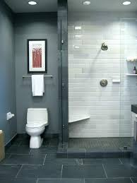 bathroom with a shower tile from the black blue walls paint color gray grout cleaner white porcelain floor natural unglazed sh