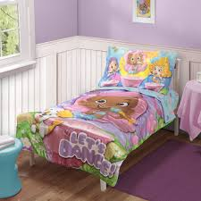 colorful bed sheets. Bed Sheets In Colorful Cartoon Characters Also White Framed Painting On Plum Wall And Sweet Purple Rugon Laminate Floor .