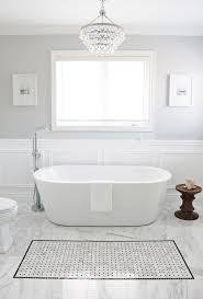 Monochromatic White Bathroom Decorated With Round Crystal Chandelier Also Light  Grey Wall Paint Color Accent