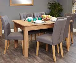 Image baumhaus mobel Door Furniture Direct Uk Baumhaus Mobel Oak Dining Set With Flare Back Grey Upholstered Chairs