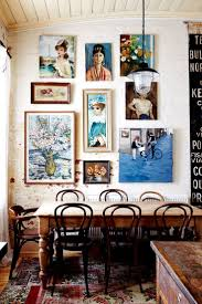 Eclectic interior decor, vintage eclectic dining room with wooden table and  wall gallery, vintage