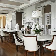 round white marble dining table: round white marble top dining table with ivory linen curved dining chairs