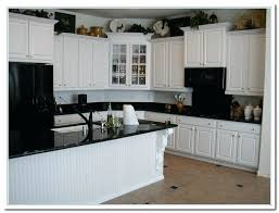 white cabinets dark details home and cabinet kitchen with brown green granite countertops full size