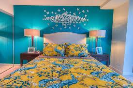 tropical master bedroom with dwellstudio pea citrine duvet cover high ceiling dwellstudio pea citrine