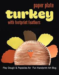 fun turkey craft footprint feathers footprints  a fun thanksgiving paper plate turkey footprint feathers craft idea