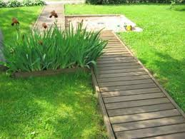 Using wood pallets we created this garden walkway. It was 100% free. Step