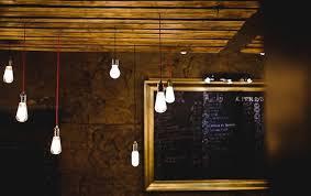 lightbulbs bare. Multiple Bare Lightbulbs Hanging From Wooden Ceiling