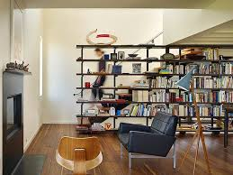 Add a touch of elegance and contemporary look by using open shelving as room  divider.