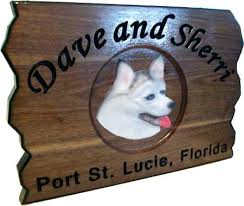 carved wood dogs sign or plaque for any use you can think of wooden dog signs
