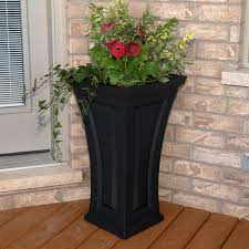 classy tall outdoor planters next to front door with mayne inc
