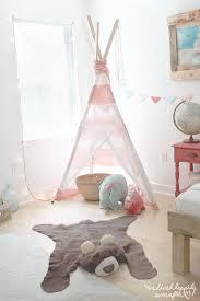 cute woodland nursery with diy bearskin rug