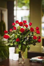 Two dozen red rose centerpiece.