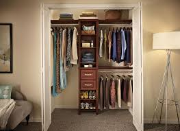 how to build closet shelves clothes rods three hanging rods shelves and two drawers closet system