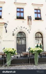 Krakow poland april 02 2017 old town street in krakow poland outdoor restaurant in summer image