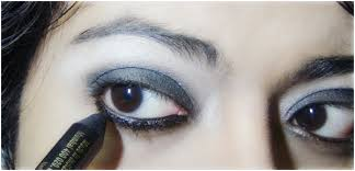 gothic eye makeup tutorial step 5 apply black pencil liner