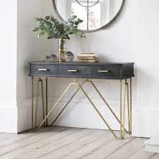 A Hallway Console Table With Storage And Chairs Modern