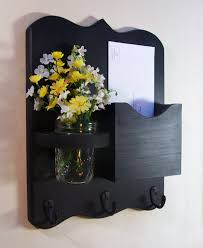 black color wall mounted mail organizer with key hooks and indoor vase storage ideas