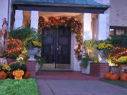 image of outdoor fall decorations flowers on door
