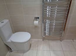 easy clean toilet with soft close seat and towel warmer 1200mm x 450mm