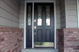 white single front doors. Black Wooden Front Door With Single Side Lights In Half Length Added By Golden Handle And White Frame On Wall Doors E