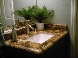 I Interior Brown Granite Backsplash And Bathroom Vanity Top  Connected By Stainless Steel Faucet