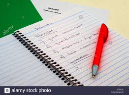 Spiral Notebook With List Of Strengths And Weaknesses On Top Of