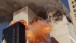 us univ students told to write essay on attacks from al  smoke billows from one of the towers of the world trade center and flames as debris