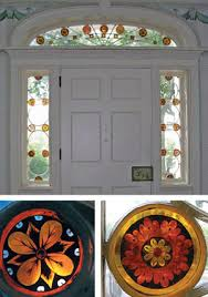 clear and stained glass in an arched transom and in sidelights flanking a paneled door