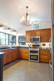 pitched ceiling lighting. pitched ceiling lighting kitchen rustic with beige floor tile grate burners