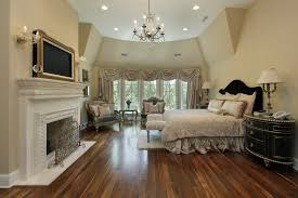 big master bedrooms couch bedroom fireplace: richly decorated master bedroom with white fireplace