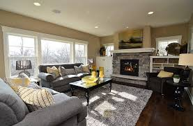 View in gallery Gray and yellow color palette lends sophistication to this  contemporary living room with a fireplace