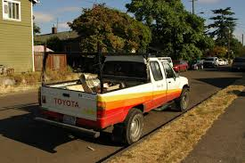 OLD PARKED CARS.: 1985 Toyota Hilux.