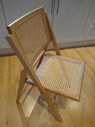 set of four john lewis folding wicker chairs in solid wood with golden oak veneer