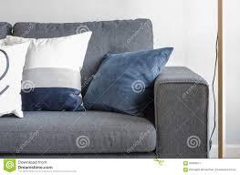 blue pillows on modern grey sofa stock photo  image