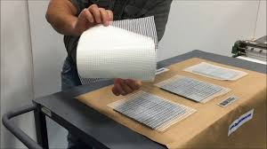 gluing sheets of mosaic tile mesh to tiles with rollcoater