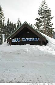 a photo of the bear valley lift ticket booth buried under 15 feet of snow
