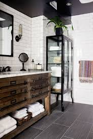 rustic and industrial bathroom decor with white subway tiles