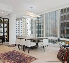 san francisco modern condo with antique carpets dining room with bidjov caucasian rugs