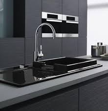 luxury kitchen sinks with grey countertop black basin long stainless faucet and wooden cabinet