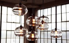 reinvent your home interior with hand blown clear band pendant lights