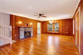 empty room interior with wooden pannel trim hardwood floor and fireplace northwest usa